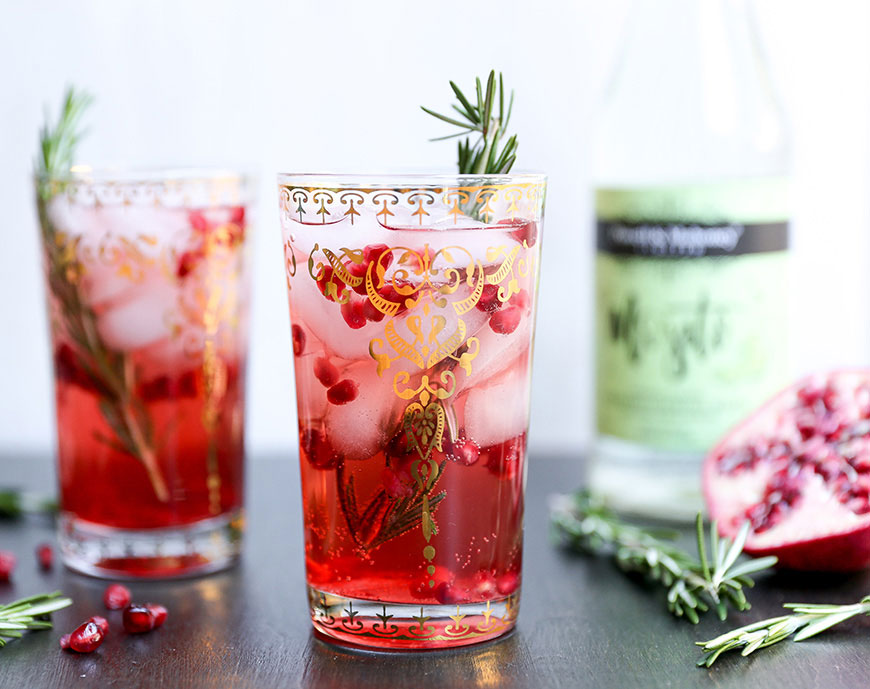 The Rosemary Pomegranate Mojito is a rum cocktail perfect for the fall and winter seasons.