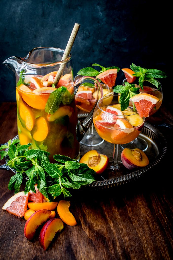 Peach Bellini Sangria: A refreshing punch recipe made with Powell & Mahoney Peach Bellini.