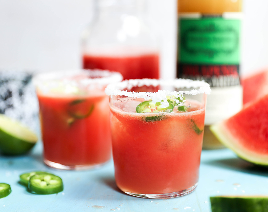 Image of a spicy watermelon basil margarita made with Powell & Mahoney Jalapeno Margarita mixer.