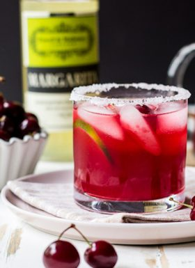 Image of a cherry margarita made with Powell & Mahoney Classic Margarita mixer.