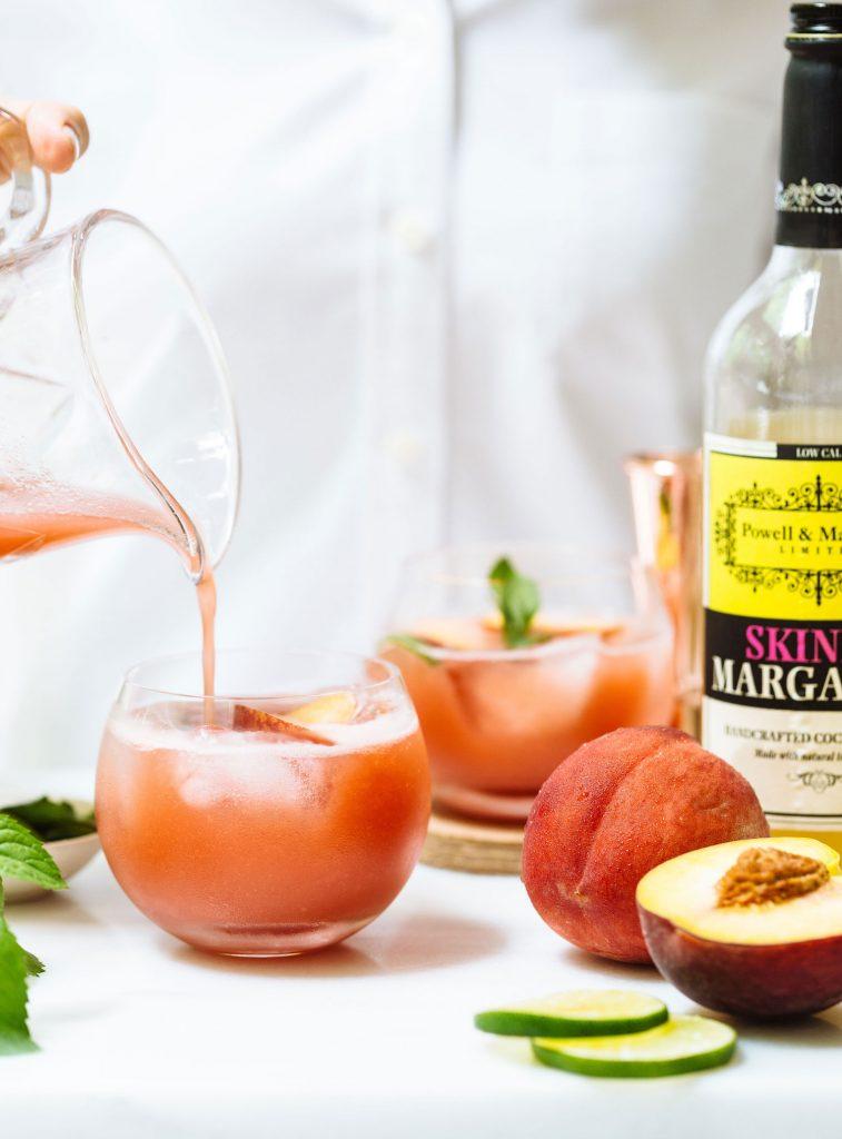 Image of a Skinny Peach Margarita made with Powell & Mahoney Skinny Margarita mixer.