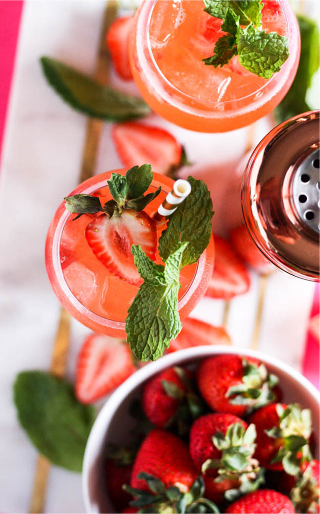 Strawberry Mango Gin Fizz as part of a series of strawberry cocktail recipes by Powell & Mahoney.