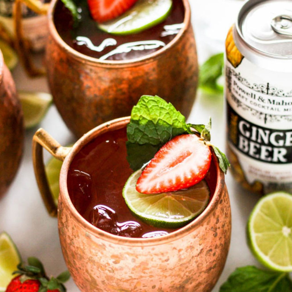 Strawberry Moscow Mule as part of a series of strawberry cocktail recipes by Powell & Mahoney.