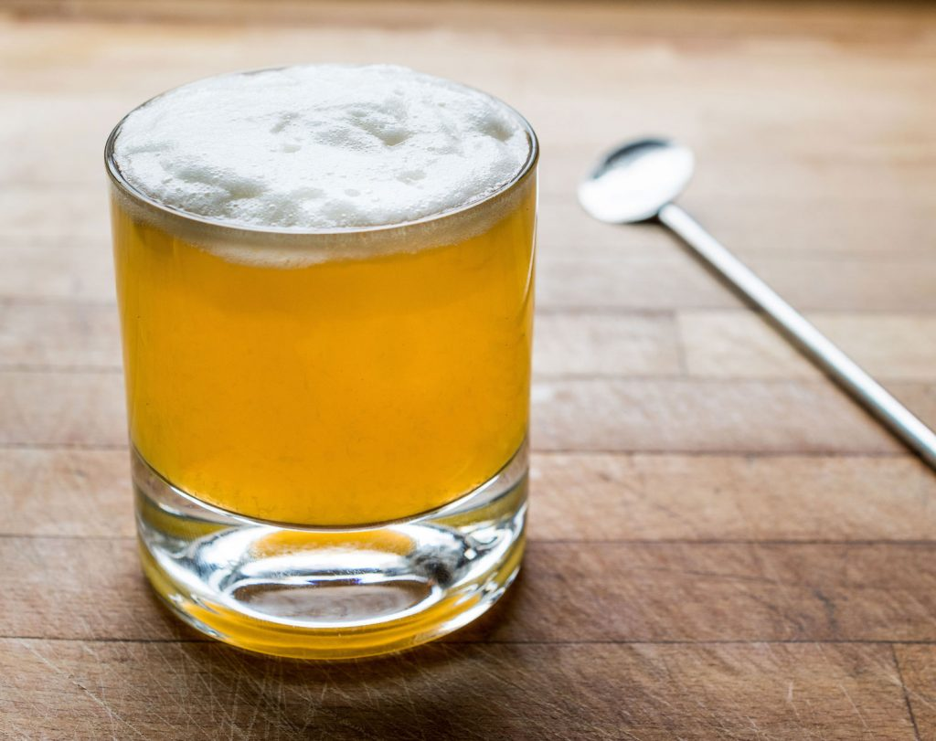 Whiskey Sour: a classic cocktail comprised of bourbon, lemon juice, and sugar.