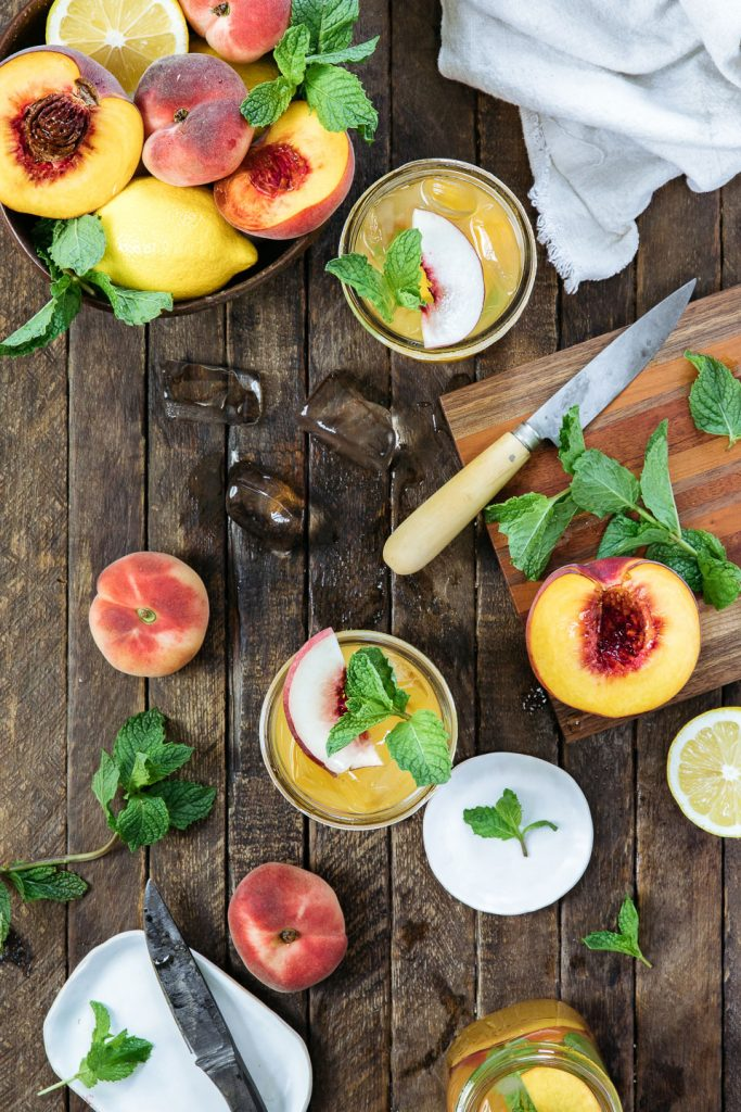 This Kentucky Peach Smash is a refreshing whiskey cocktail made with bourbon, P&M Peach Bellini, fresh lemon juice, simple syrup, and mint.