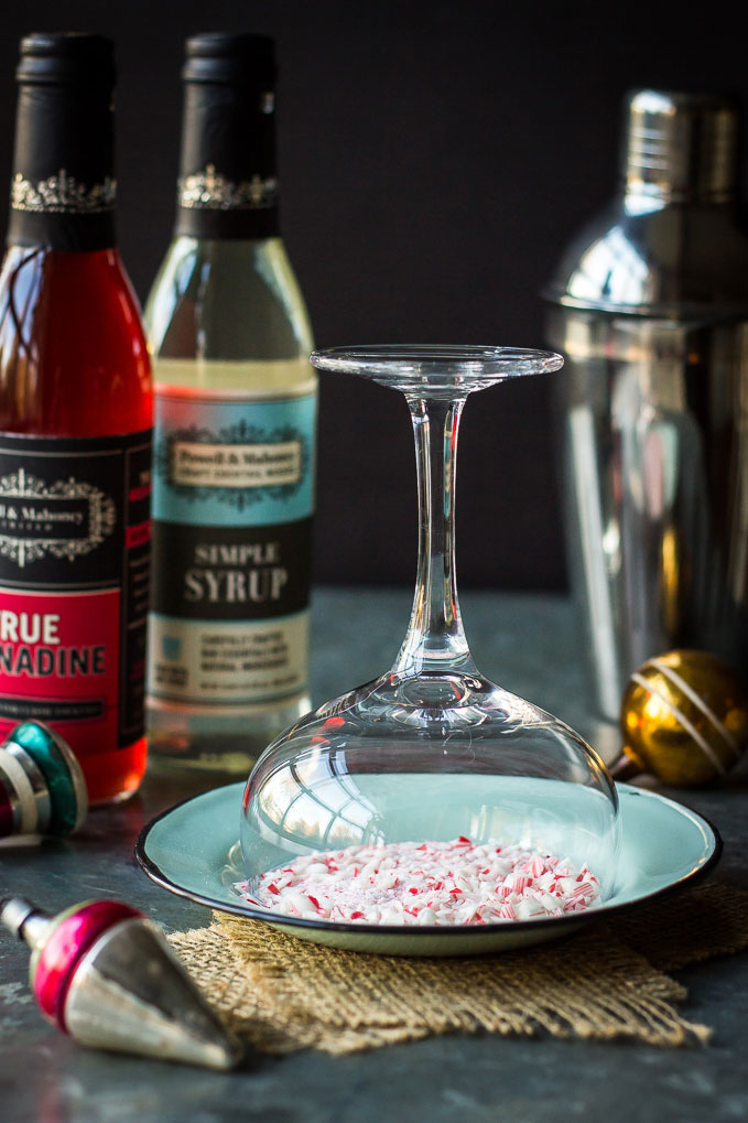 This Candy Cane Martini is sweet, festive, and ready for the holidays! Made simply with P&M True Grenadine and Simple Syrup.
